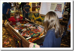 2 girls playing Joust Pinball